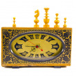 Ancient clock and vintage chess figures on white — Stok fotoğraf