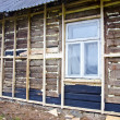 Stock Photo: Old rural wooden house restoration and insulation