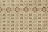 Old and ornamental linen tablecloth background — Stock Photo