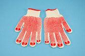 Ochranné rukavice na Azurovém pozadí — Stock fotografie