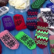 Assorted handmade knitted mittens collection in fair — Stock Video