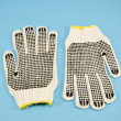 Stock Photo: Two protective glove on azure background