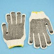Two protective glove on azure background - Stock Photo
