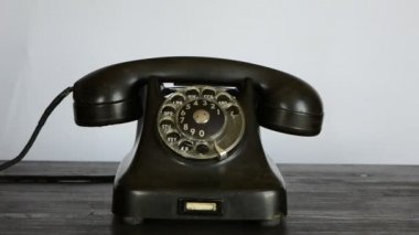 Gangster hand with black glove calling telephone — Stock Video