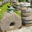 Historical millstone collection in farm — Stock Photo