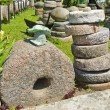 Stock Photo: Historical millstone collection in farm