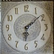 Stock Photo: Vintage clock ornamental dial