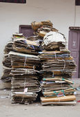 Waste paper cardboard for recycling in street — Stock Photo