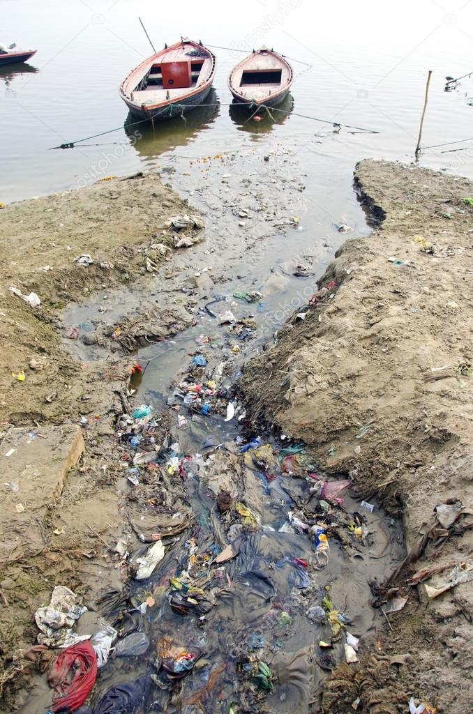 Sewage water pollution channel to holy Ganges river In Varanasi, India