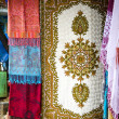 Tibetan national shawls in Dharamsala, India - Stock Photo