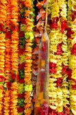 Beautiful flowers garlands in Delhi market — Stock Photo