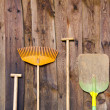 Stock Photo: Farmers tools on old barn wall background