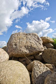 Natural stones on field and sky — Stock Photo