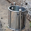 Stock Photo: Metal dustbin in Agrcity street, India