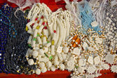 Glass and camel bone jewelry in street market, India — Stock Photo