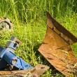 Old rusty tractor plow on grass in farm — Stock Photo