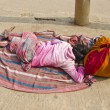 Indian woman with colorful sari sleeping in Varanasi, India — Stock Photo