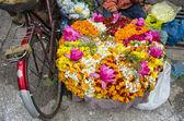 Various flowers in Varanasi street market, India — Stock Photo