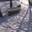 Snowy wooden boat on river coast in winter — Stock Video #21782369