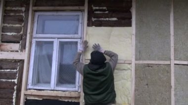 Old house wall insulation with mineral rock wool works — Stock Video