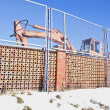 Industrial place fence and old excavator machine — Stock Photo #21896597