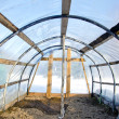 Royalty-Free Stock Photo: Homemade plastic arch empty  greenhouse in winter