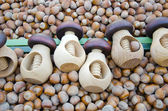 Wooden nutcrackers and hazelnuts in market — Stock Photo