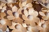 Wooden handmade craft flowers in market — Stock Photo