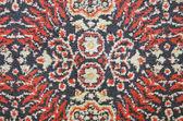 Old carpet fragment background — Stock Photo