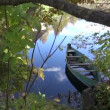 Old lonely  boat in autumn river — Stock Video