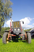 Ancient tractor in farm — Stock Photo