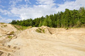 Sand quarry in the forest — Stock Photo