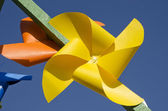 Yellow paper windmill toy — Stock Photo