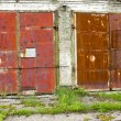 Two old and rusted garage doors — Stock Photo