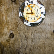 Old aged clock face on wooden background — Stock Photo