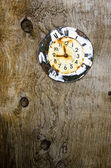 Old aged clock face on wooden background — Stok fotoğraf