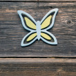 Stock Photo: Decorative wooden butterfly on old farm wall