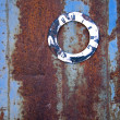 Ancient clock face on rusty metal tin — Stock Photo