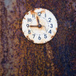 Rusted ancient clock face on tin background — Stock Photo