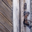 Old wooden door fragment with metal handle — Zdjęcie stockowe
