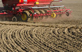 New agriculture cereal grain seeder machinery working on field — Stock Photo