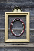 Two picture frame on old wooden wall — Stock Photo