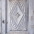 Old carved wooden door fragment background — Stock Photo