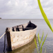 Foto Stock: Old fishing boat floating on sewater