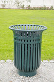 Green metal garbage bin box in park — Stock Photo