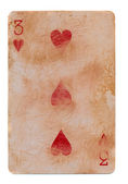 Old grunge playing card with three red hearts isolated on white — Stock Photo