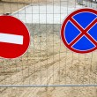Road signs on street repair fence — Stock Photo