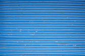 Blue metal shop door background — Stock Photo