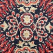 Old used ornamental carpet background — Stock Photo