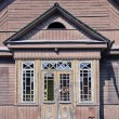Old derelict wooden house facade — Stock Photo